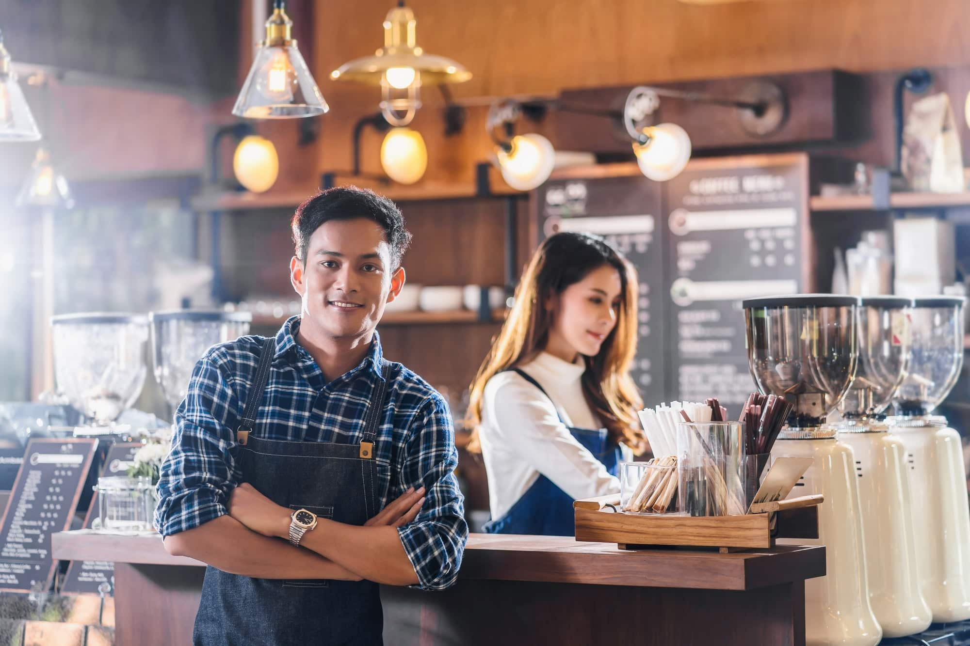 Portrait of Asian Young Small business owner with coffee shop in front of counter bar